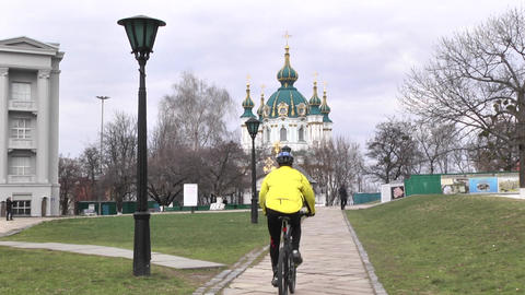 A man riding a bike during the day. Sports lifestyle. Slow motion. Kyiv. Ukraine Live Action
