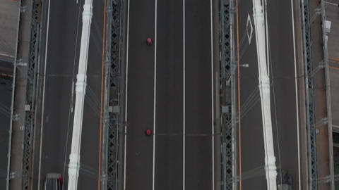 AERIAL: Birds perspective of Bridge with car traffic Live Action