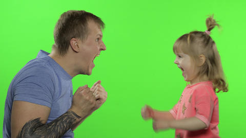 Father and little daughter laughing, playing together. Chroma Key. Leisure games Live Action