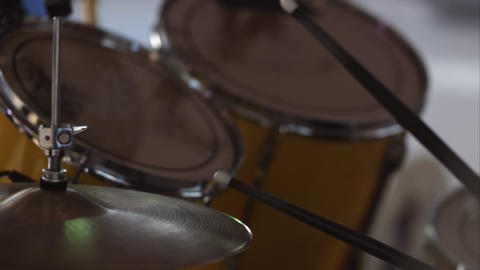 Close up view of drumsticks hitting drums Live Action