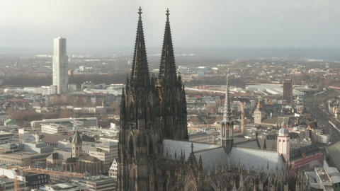 AERIAL: Towards Beautiful Cologne Cathedral with Central Train Station in Live Action