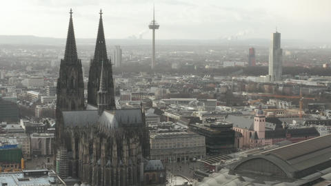 AERIAL: Circling around Beautiful Cologne Cathedral with Central Train Station Live Action