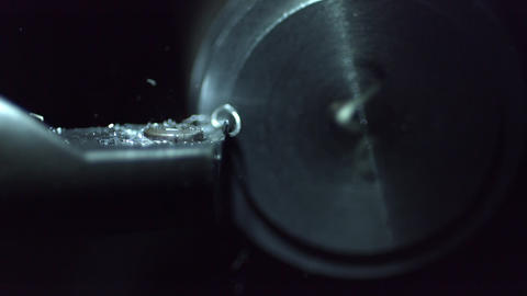 Slow motion of metal lathe carving metal Live Action