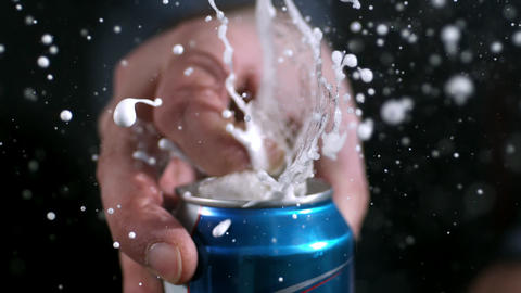Slow motion of aluminum can opening and spraying as tab is being pulled Live Action