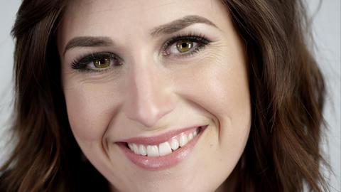 Attractive brunette smiling Live Action