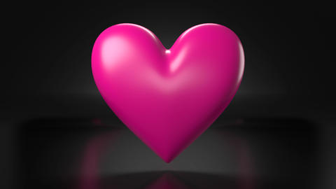 Pulsing pink heart shape object on black background Animation