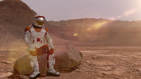 Astronaut sitting on Mars and admiring the scenery. Exploring Mission To Mars Live Action