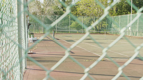 Abandoned and neglected tennis court due to corona virus outbreak Live Action