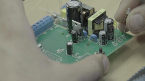 A worker is working on the production of an electronic…, Live Action