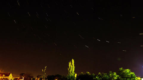 Star Trails over the Small Town Footage
