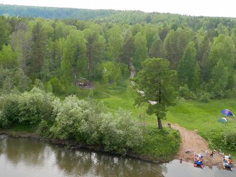 Suspended Bridge. The river Serga, Russia Live Action