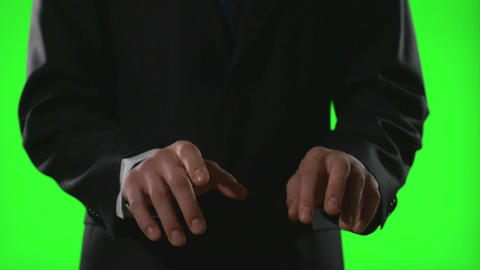 Young businessman making typing gestures in a virtual business environment on gr Footage