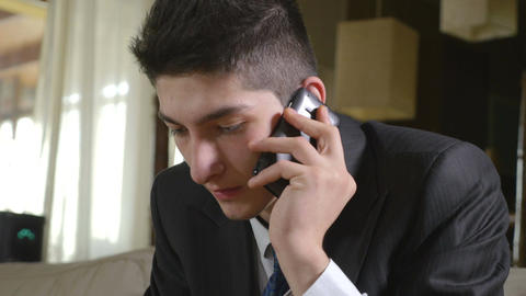 Young handsome businessman talking at the smart phone Footage