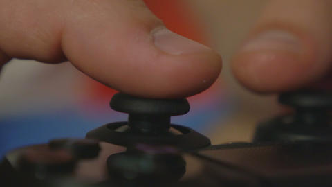 Close-up of man hands playing console games with a controller Footage