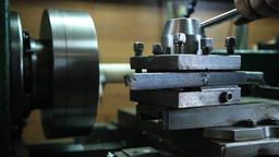 Worker in uniform operating manual lathe Footage