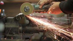 Worker cutting metal workpiece with circular saw Footage