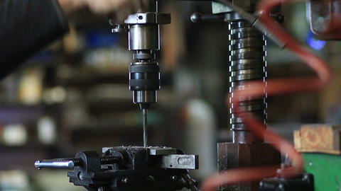 Man drilling in steel plate with bench drill Footage