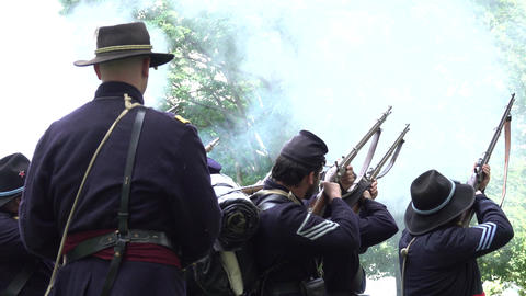 Civil War soldiers firing guns in formation Footage