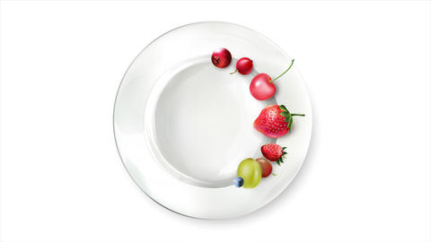 Still life of berries arranged in a circle on a white plate Live Action