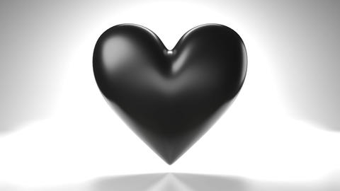 Pulsing black heart shape object on white background Animation