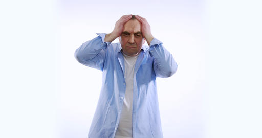 Mature man having terrible headache, isolated on white background. People Live Action