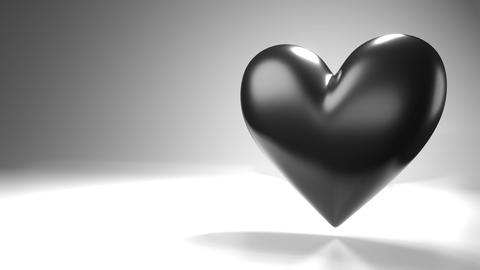 Pulsing black heart shape object on white text space Animation