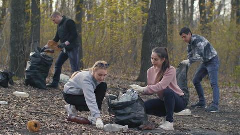 Volunteers picking up garbage plastic Live Action
