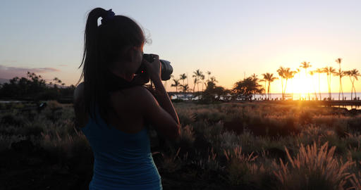 Woman taking photos on Paradise beach sunset with tropical palm trees. Summer Live Action