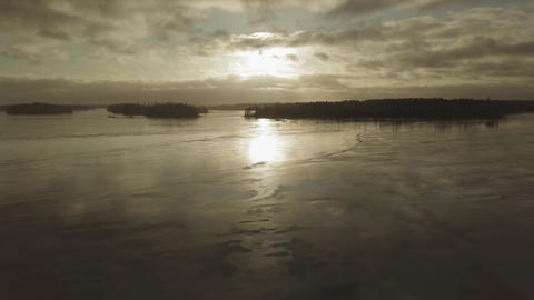 Flying over wet ice of frozen lake during sunset in springtime in Finland Live Action