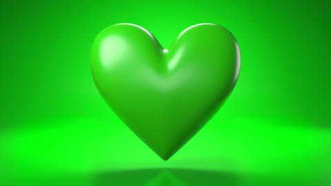 Pulsing green heart shape object on green background Animation
