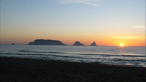 Unspoiled Mediterranean beach and islands at sunrise time lapse Live Action