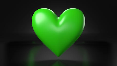 Pulsing green heart shape object on black background Animation