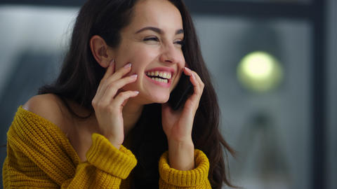 Cheerful girl laughing cellphone at workplace. Relaxed business woman smiling Live Action