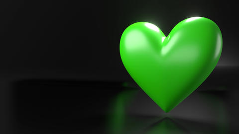 Pulsing green heart shape object on black text space Animation