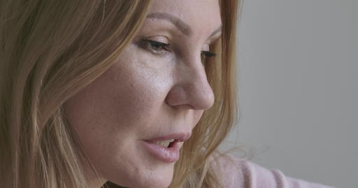 Side view face of adult blond woman talking. Extreme close-up of adult lady Live Action