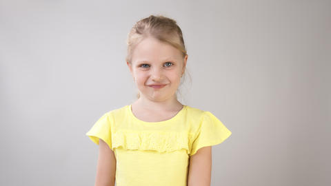 Emotions of a little girl. Portrait of a girl in a yellow…, Live Action