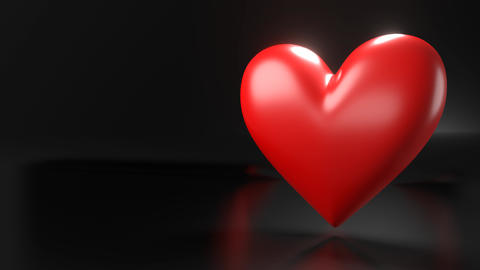Pulsing red heart shape object on black text space Animation
