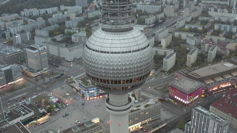AERIAL: Close Up of Berlin Germany TV Tower Alexanderplatz at Daylight with Live Action