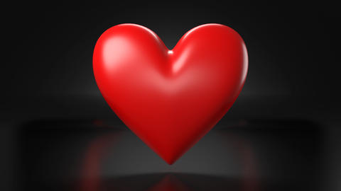 Pulsing red heart shape object on black background Animation
