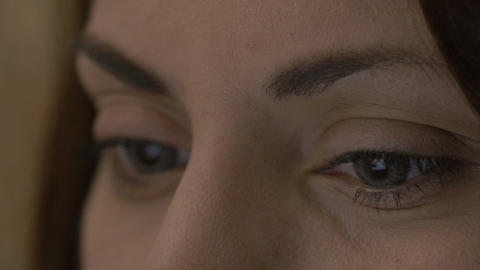 Close-up of female eyes with contact lenses looking at a tablet Footage