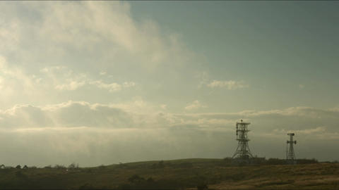 Steel tower and cloud stream at Takabocchikogen Footage
