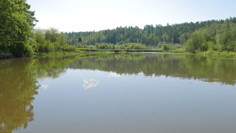 Smooth surface of water, River Serga, Urals, Russia Footage