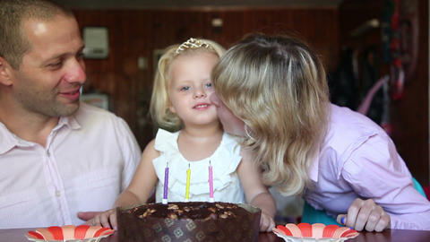 Happy moment european family blows out the candles on the cake Footage