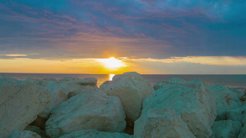 Timelapse of fantastic sunrise over sea. White stones on coast. Luxury resort Footage