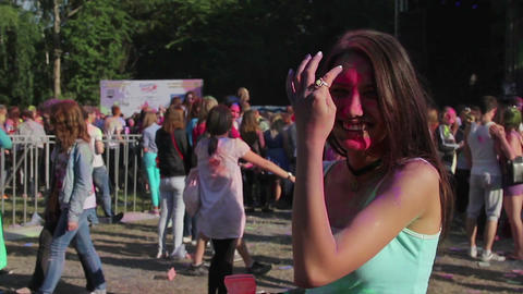 Covered in paint pretty girl smiling, laughing, flirting, looking at camera Footage