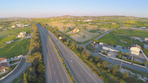 Modern transport infrastructure. Top view of road, fields, rural area. Aerial Footage