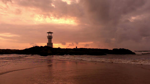Lighthouse at sunset beach Footage