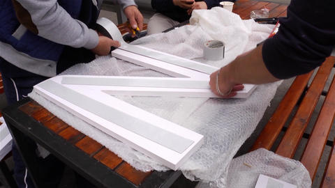 Worker who sticks sticky paper on a point of polystyrene 72 Live Action