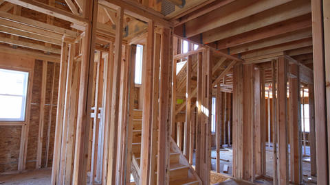 Home Framing unfinished wood frame building or a house Live Action