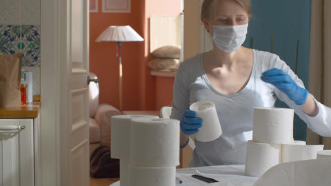 Young woman with a lot of toilet paper Live Action